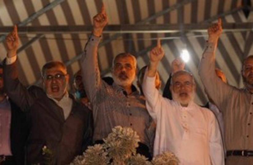 Hamas PM Haniyeh celebrates prisoner deal in Gaza 311 (photo credit: Reuters)