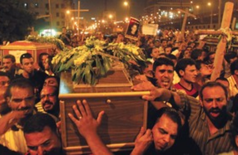 COPTS ATTEND a mass funeral in Cairo R 311  (photo credit: Mohamed Abd El-Ghany/Reuters)