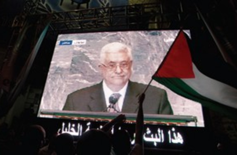 Mahmoud Abbas on tv 311 (photo credit: AMMAR AWAD / REUTERS)