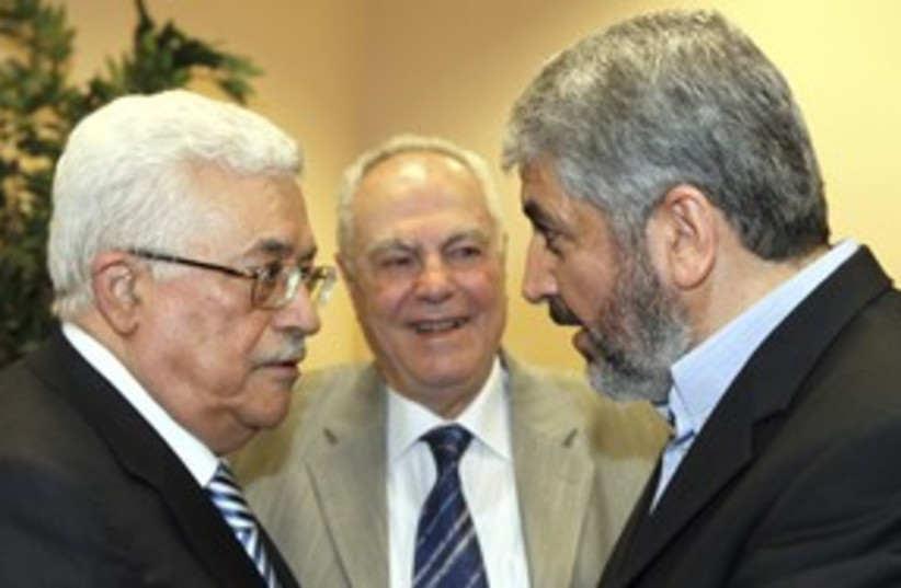 PA President Abbas with Hamas leader Khaled  Mashaal 311 (R) (photo credit: REUTERS/Ho New)