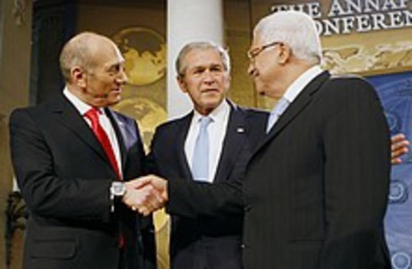 olmert bush abbas shake  (photo credit: AP)