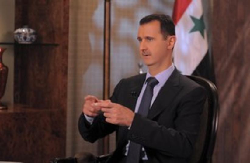Syrian President Bashar Assad 311 (R) (photo credit: Sana / Reuters)