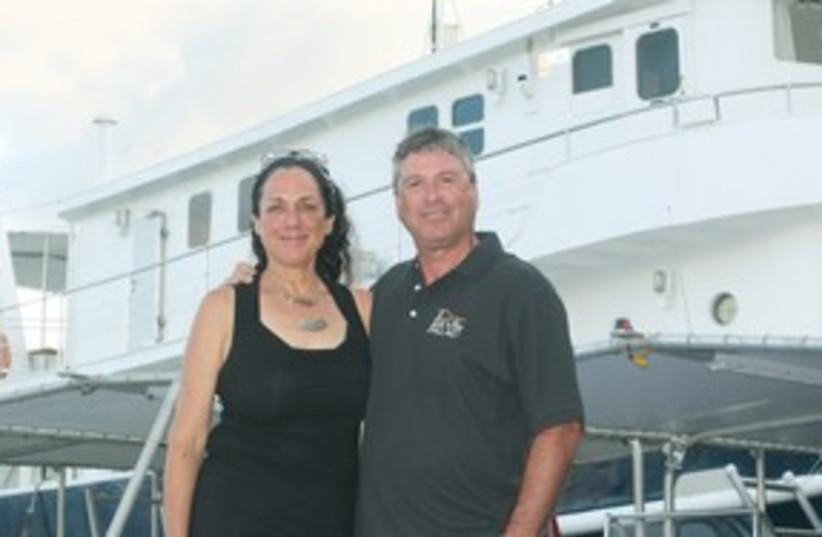 Tova and Navot Bornovski in front of Ocean Hunter III (photo credit: George Medovoy)