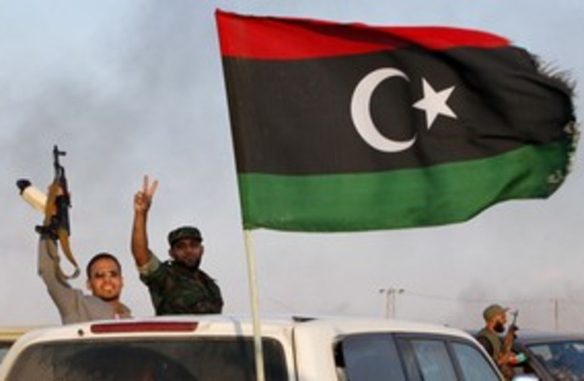 Libyan rebels celebraye in Bani Walid_311 (photo credit: Reuters)