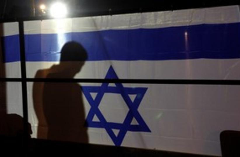 Flag awaiting schalit 311 (photo credit: REUTERS/Eric Gaillard )