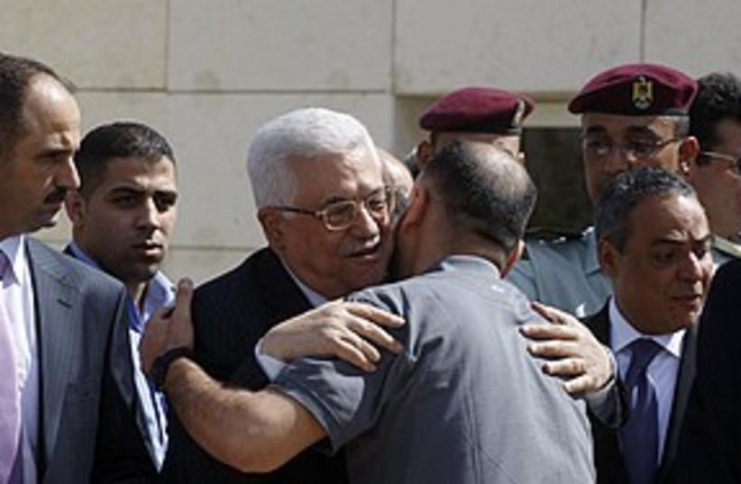 Abbas greets prisoners 311 R (photo credit: REUTERS/Abed Omar Qusini)
