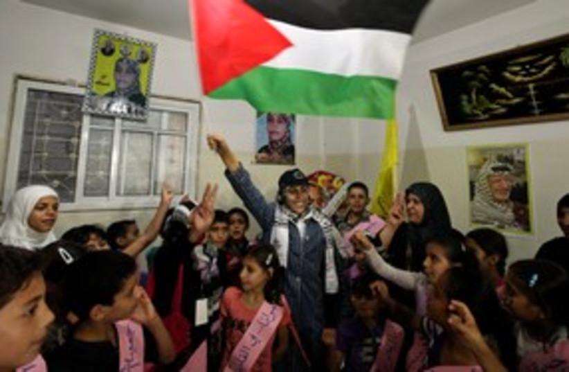 Freed Palestinian terrorist Wafa Al-Biss 311 (R) (photo credit: REUTERS/Mohammed Salem)