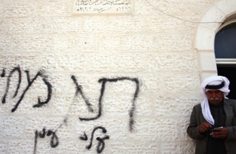 price tag attack on Mughayyir mosque DO NOT USE (photo credit: ISSAM RIMAWI /Flash 90)