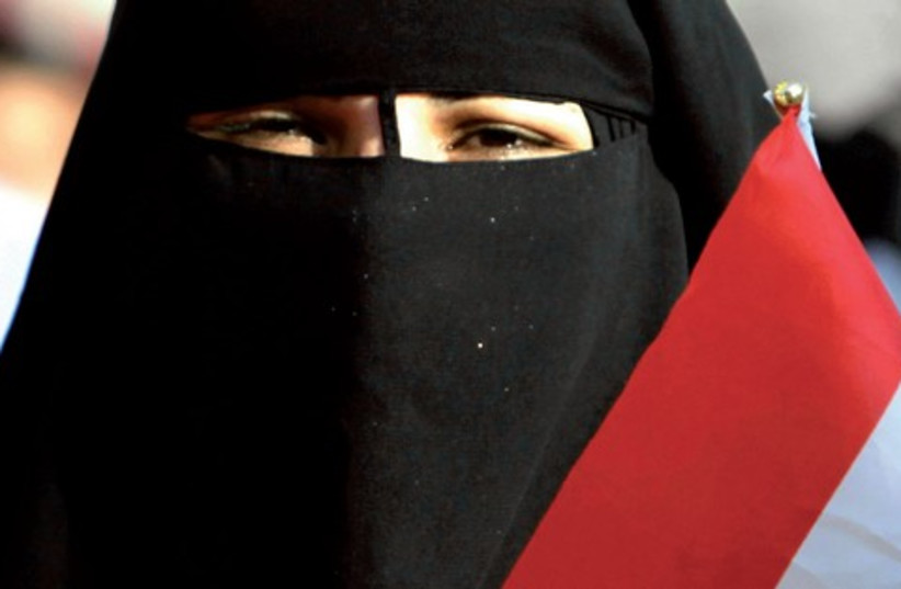 Muslim woman whose veil is decorated with the Egyptian flag (photo credit: REUTERS)