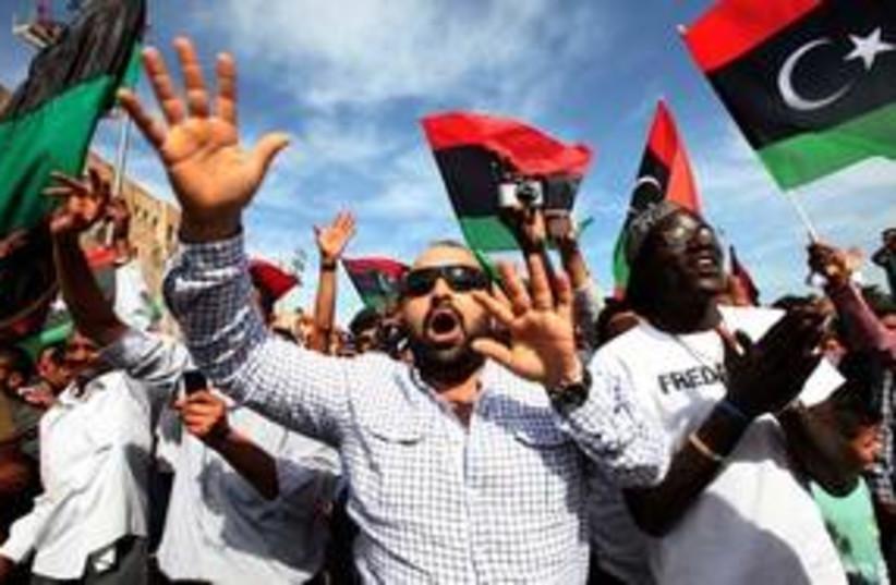 Libyans celebrate news of Muammar Gaddafi's death 311 (R) (photo credit: REUTERS/Ismail Zitouny)