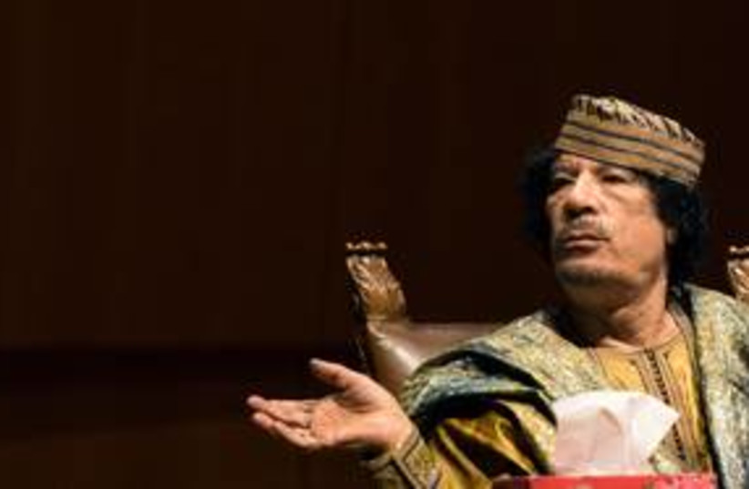 Former Libyan leader Muammar Gaddafi 311 (R) (photo credit: REUTERS/Alessandro Bianchi)