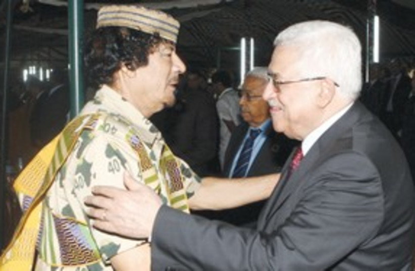 Mahmoud Abbas with Muammar Gaddafi 311 (R) (photo credit: Reuters)