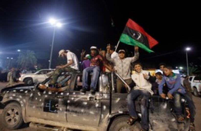 Libyans celebrate death of Gaddafi 311 (photo credit: REUTERS)