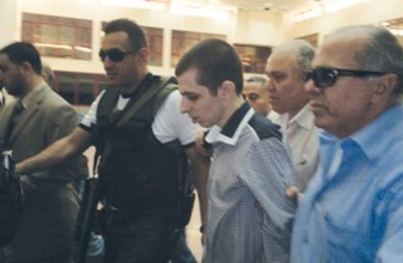 Schalit with Hamas 311 R (photo credit: Reuters)