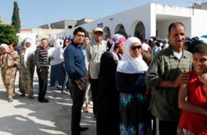 Voters line up in Tunisia 311 (R) (photo credit: REUTERS/Jamal Saidi)