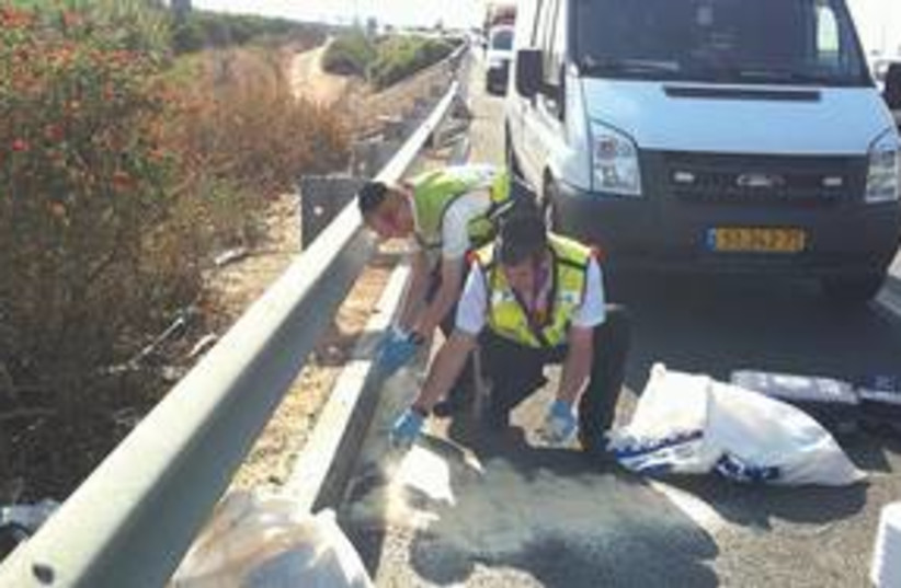 ZAKA workers remove bodies from a car crash 311 (R) (photo credit: REUTERS)