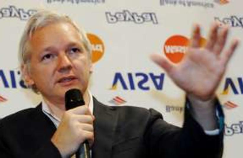 WikiLeaks founder Julian Assange speaks to press 311 (R) (photo credit: REUTERS/Luke MacGregor)
