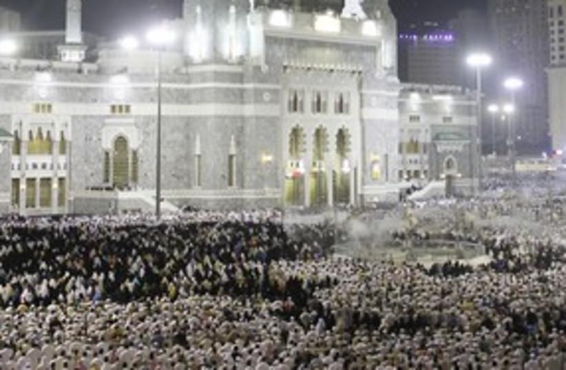 Muslims praying in Mecca R 311 (photo credit: REUTERS/Hassan Ali )