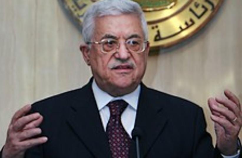 Abbas hands out 224.88 (photo credit: AP)