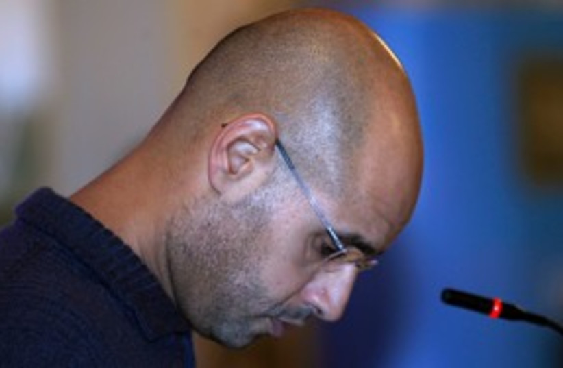 Saif al-Islam Gaddafi 311 (R) (photo credit: REUTERS/Ahmed Jadallah)