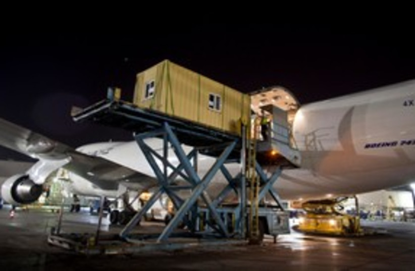 Prefabricated homes are loaded onto an ElAl cargo jet 311 (R (photo credit: REUTERS/ Nir Elias)