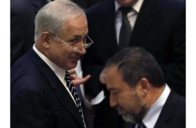 PM Binyamin Netanyahu and FM Avigdor Lieberman 311 (R) (photo credit: Ronen Zvulun / Reuters)
