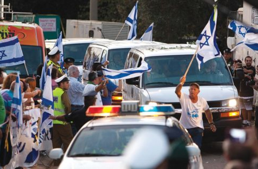 Israeli flags 521 (photo credit: REUTERS)
