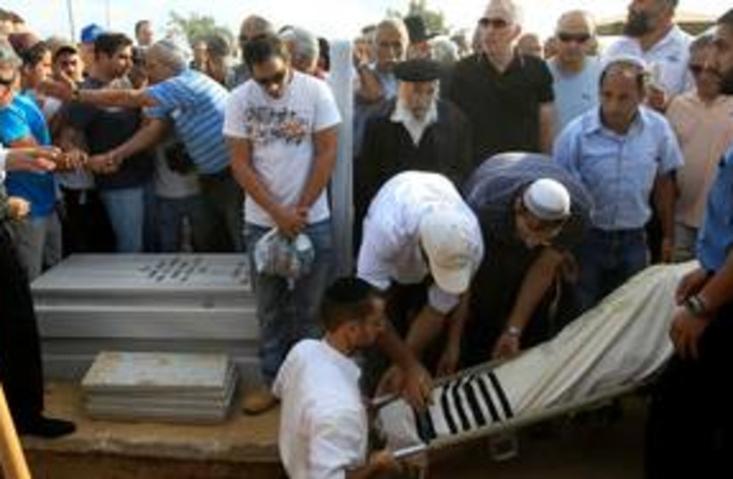 Funeral for rocket victim Moshe Ami 311  (R) (photo credit: REUTERS/Ronen Zvulun)