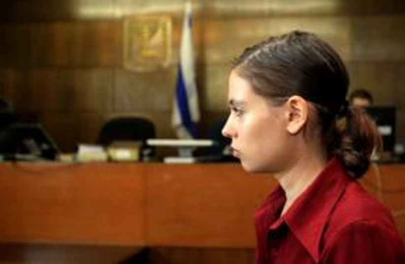 Anat Kamm stands inside a courtroom in Tel Aviv 311 (R) (photo credit: REUTERS/Ronen Zvulun)