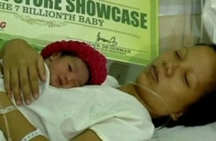 7 billionth baby 311 R (photo credit: Reuters)