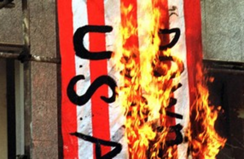 Iranians burn US flag 311 R (photo credit: Reuters)