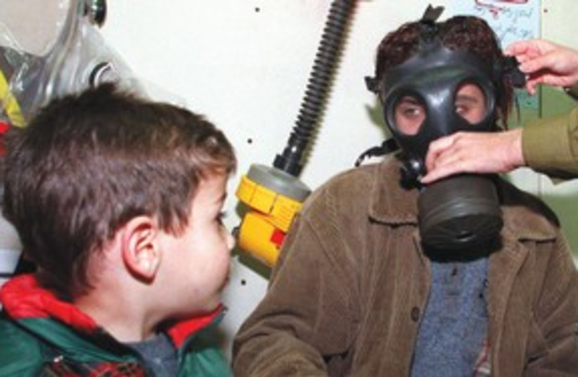 Gas mask kids 311 (photo credit: REUTERS)