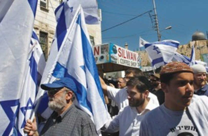 Right wing activists march in J'lem R 311 (photo credit: Reuters)