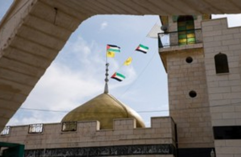 Palestinian flags, mosque_311 (photo credit: Thinkstock/Imagebank)
