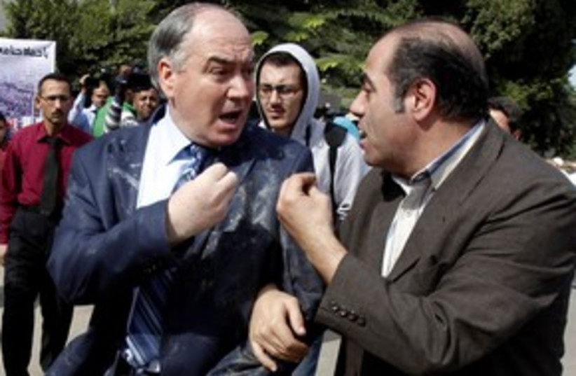 Member of Syrian opposition egged by demonstrators (photo credit: Reuters)