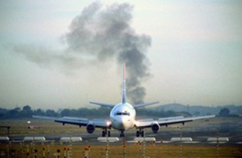 airplane, smoke [illustrative]_311 (photo credit: Thinkstock/Imagebank)