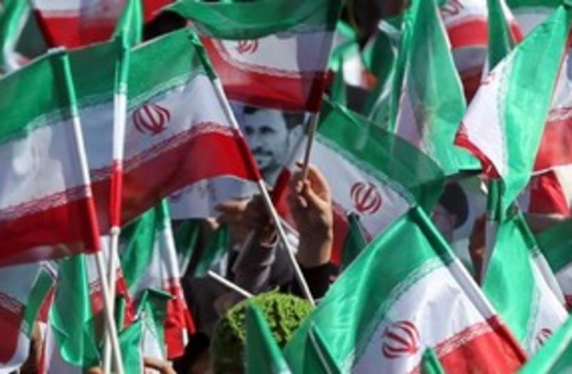 Iran flags ahmadinejad 311 (photo credit: REUTERS)