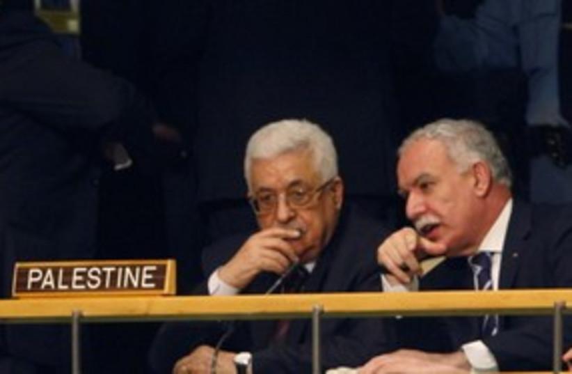 PA President Abbas with FM Riad Malki at the UN 311 (R) (photo credit: REUTERS/Jessica Rinaldi)