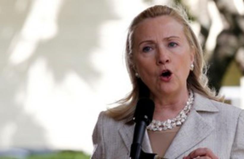 Hillary Clinton speaking 311 R (photo credit: REUTERS/Yuriko Nakao )