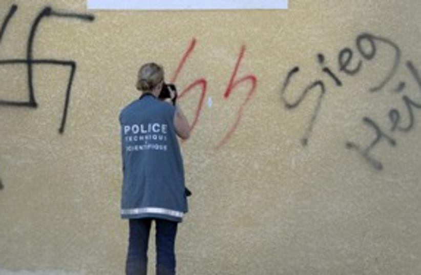 Swastika grafitti 311 (photo credit: REUTERS)