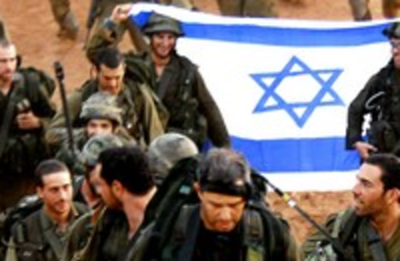 IDF soldiers march with flag 300 (photo credit: REUTERS/Dan Bronfeld)