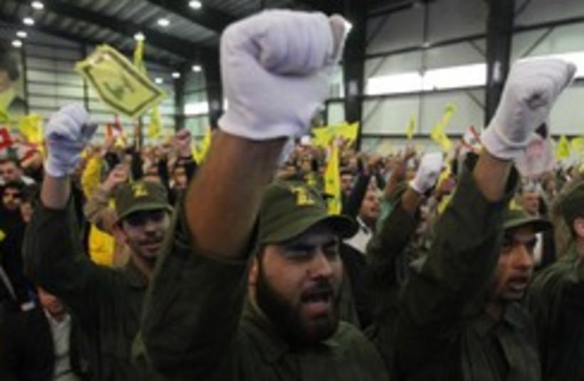 Hezbollah militants chant 260 (photo credit: REUTERS/Sharif Karim)