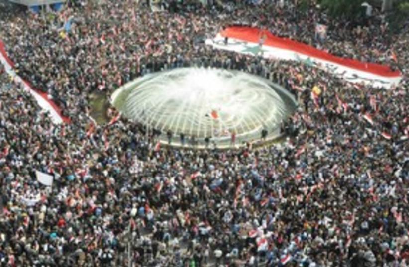 Pro-Assad Syrian protesters 311 (R) (photo credit: REUTERS/Sana/Handout)