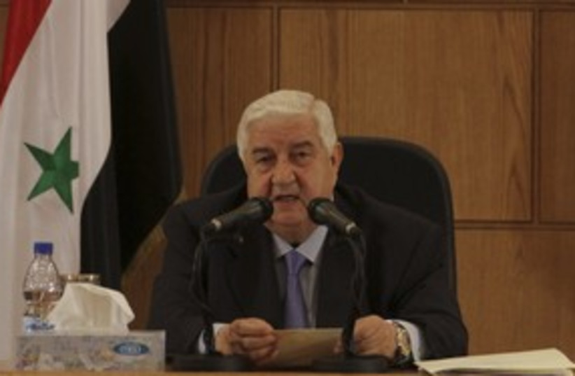 Syrian Foreign Minister Walid Mouallem 311 (R) (photo credit: Ho New / Reuters)
