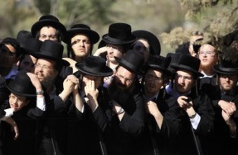 Haredi orthodox Jewish men protest 311 (R) (photo credit: Ammar Awad / Reuters)