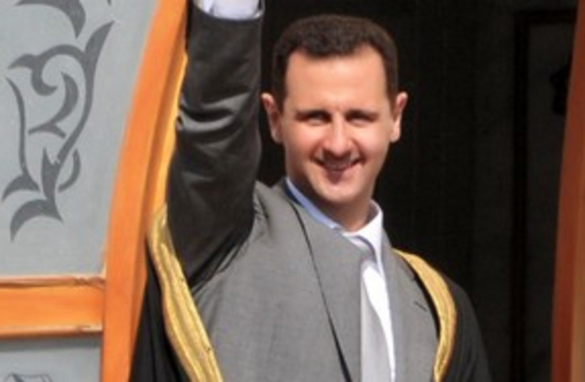 Syrian President Bashar Assad 311 (R) (photo credit: REUTERS/SANA/Handout)