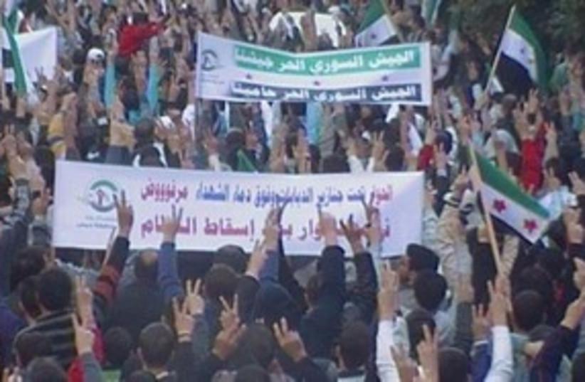 Homs demonstration 311 (photo credit: REUTERS)