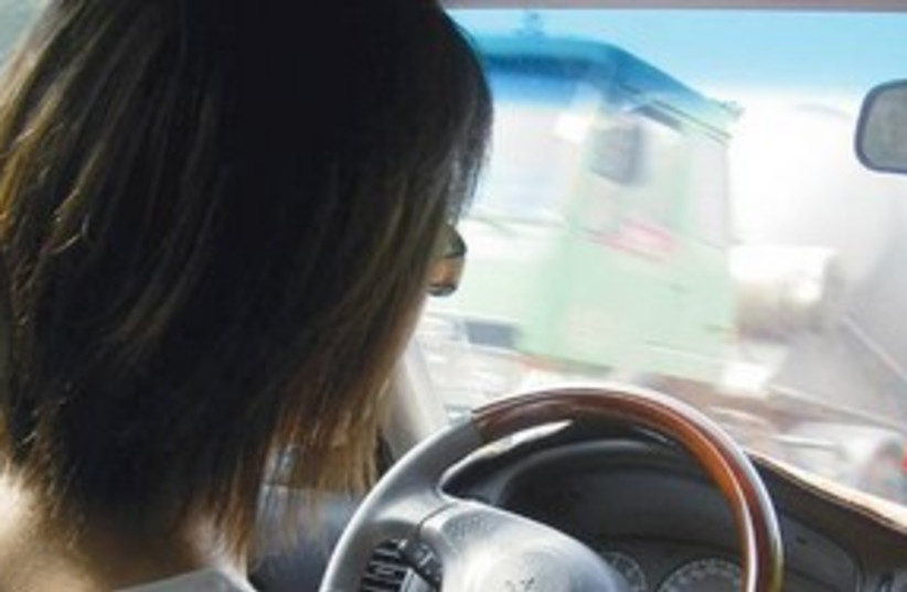 Woman driving 311 (photo credit: Thinkstock)