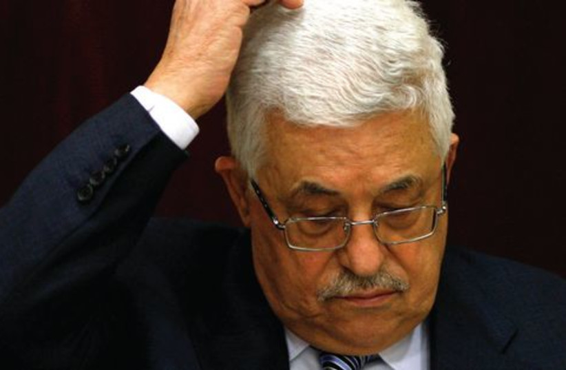 Abbas scratching head 521 (R) (photo credit: MOHAMAD YOROKMAN / REUTERS)