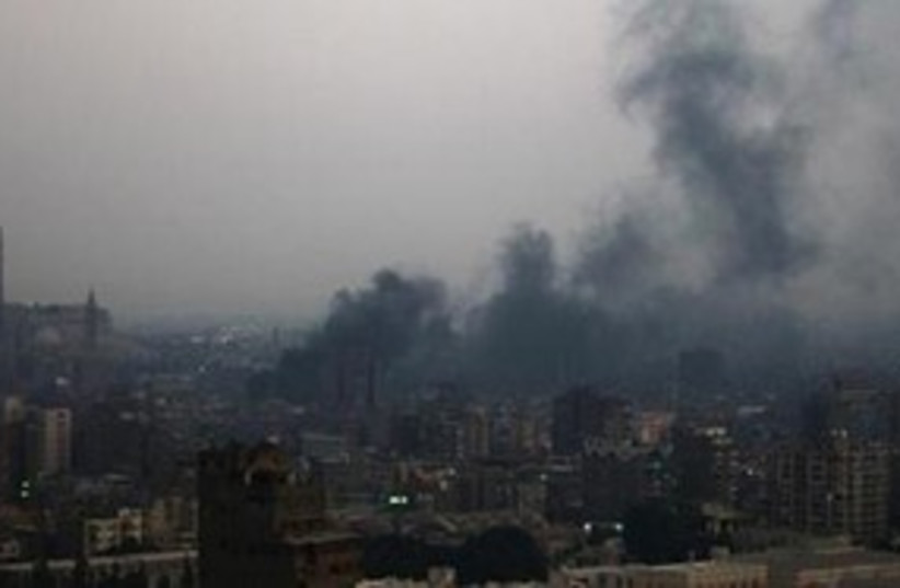 Smoke rises from burning garbage town in Cairo 311 R (photo credit: REUTERS/Amr Abdallah Dalsh)